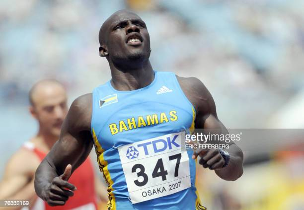 Bahamas' Derrick Atkins looks at the time board after the men?s 100m first round, 25 August 2007, at the 11th IAAF World Athletics Championships, in...