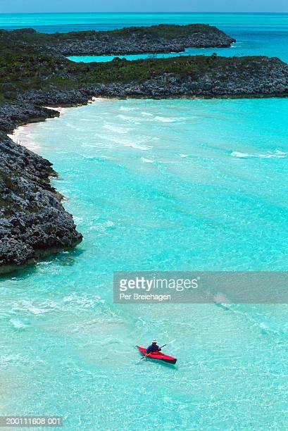 Bahamas, Exumas Islands, man sea kayaking, elevated view