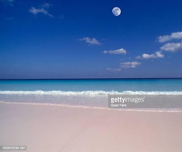 bahamas, harbour island, beach, dusk (digital composite) - harbor island bahamas stock photos and pictures