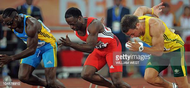 Bahamas Jamial rolle Trinidad and Tobago's Aaron Armstrong and Australia's Aaron RougeSerret compete during the Men's 100m qualification event of the...