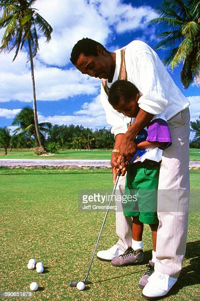 Bahamas Nassau Cable Beach Father Teaching Son How To Swing Golf Club