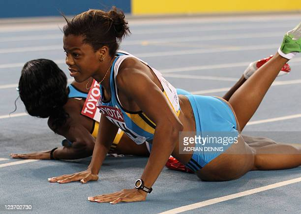 Bahama's Nivea Smith and Bahama's Anthonique Strachan react after the women's 4x100 metres relay heats at the International Association of Athletics...