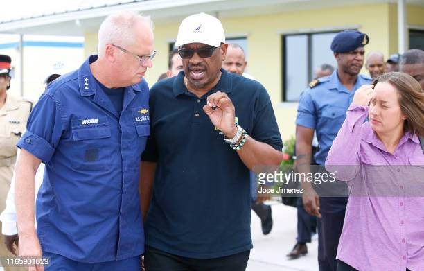Bahamas Prime Minister Hubbert Minnis and US Coast Guard Admiral Scott A. Buschman prepare to board a US Coast Guard plane for a reconnaissance...