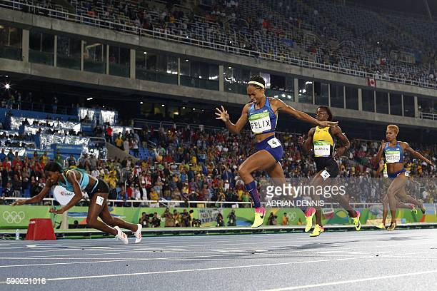 Bahamas' Shaunae Miller falls at the finish line ahead of USA's Allyson Felix to win the Women's 400m Final during the athletics competition at the...