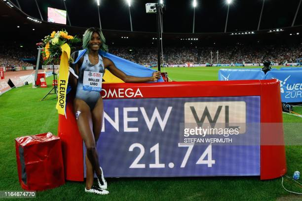 Bahamas' Shaunae Miller-Uibo poses next to the screen reading her new record time in the Women 200m after winning the race during the IAAF Diamond...