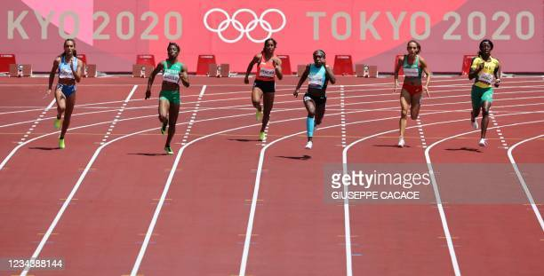 Bahamas's Anthonique Strachan wins the women's 200m heats during the Tokyo 2020 Olympic Games at the Olympic Stadium in Tokyo on August 2, 2021.