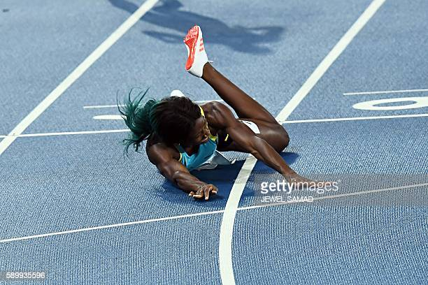 Bahamas's Shaunae Miller crosses the finish line to win the Women's 400m Final during the athletics event at the Rio 2016 Olympic Games at the...