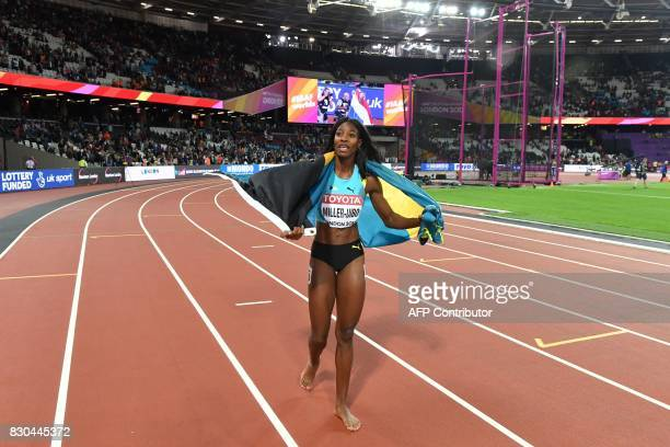 Bahamas's Shaunae MillerUibo celebrates taking bronze after the final of the women's 200m athletics event at the 2017 IAAF World Championships at the...