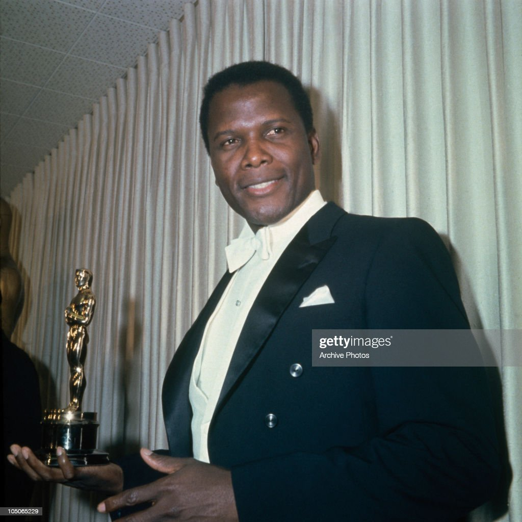 Bahamian American actor Sidney Poitier holding his Academy Award for Best Actor in a Leading Role for 'Lilies Of The Field', directed by Ralph Nelson, at the 36th Academy Awards ceremony, 13th April 1964. The ceremony was held at the Santa Monica Civic Auditorium, Santa Monica, California.