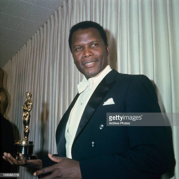 Bahamian American actor Sidney Poitier holding his Academy Award for Best Actor in a Leading Role for 'Lilies Of The Field', directed by Ralph...
