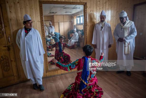 Bahand Pather the traditional folk entertainers of Kashmir rehearsal back stage before performing on the stage on March 23 2019 in Srinagar the...