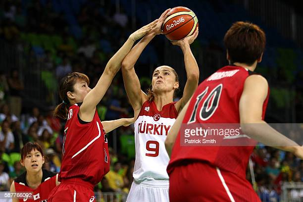 Bahar Caglar of Turkey shoots in front Moeko Nagaoka of Japan in the Women's Basketball Preliminary Round Group A match between Turkey and Japan on...