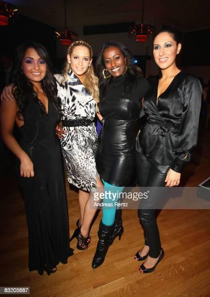 Bahar Kizil Mandy Capristo their manager Joy Berhanu and Senna Guemmour members of the girl band Monrose hold up their first golden disc during the...