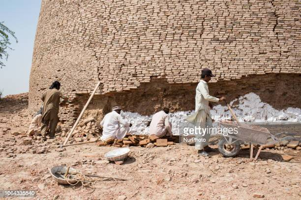Bahawalpur, Pakistan, 5 October 2018. Workers renovate the ramparts Derawar Fort in the Cholistan desert where the walls have a perimeter of 1,500 m...