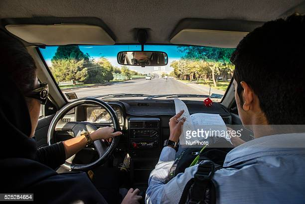 Bahor Muslim women drives car with his younger teenage brother Parsa Isfahan Iran