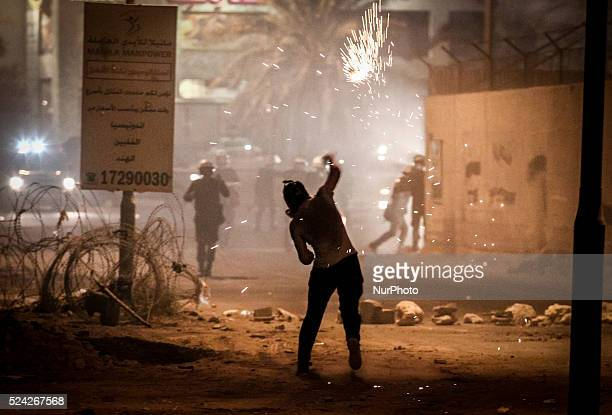 Bahrain Abu Saiba protester throw molotov cocktail during the clashes Clashes between protesters and riot police in Bahrain independence day Bahrain...