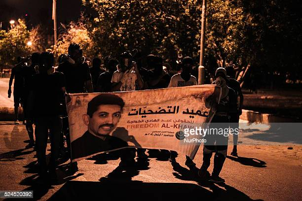 Bahrain , Abu Saiba - protesters holding a banner with Abdulhadi AlKhawaja picture demanding to release him , Demonstration in solidarity with Human...