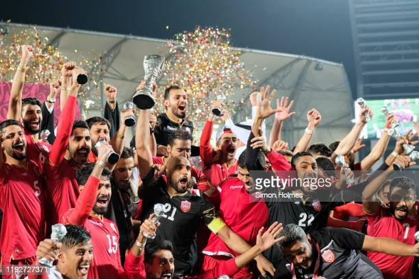 Bahrain captain Sayed Mohammed Jaffer lifts the Gulf Cup trophy as his teammates celebrate after their 1-0 win over Saudi Arabia at the Abdullah bin...