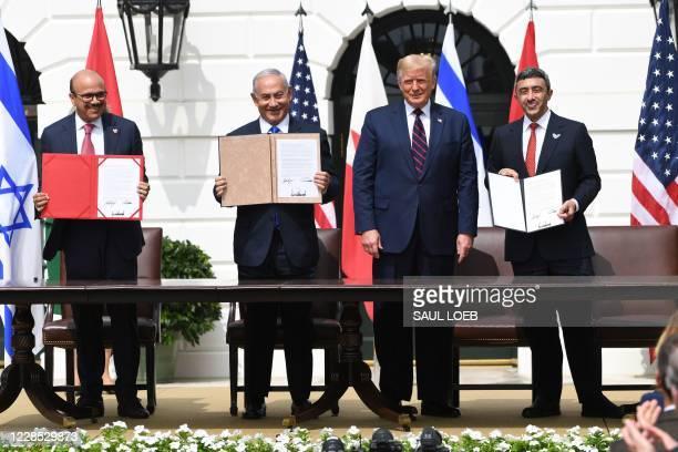 TOPSHOT Bahrain Foreign Minister Abdullatif alZayani Israeli Prime Minister Benjamin Netanyahu US President Donald Trump and UAE Foreign Minister...