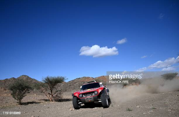 Bahrain JCW XRaid team Spanish drivers Carlos Sainz of Spain and codriver Lucas Cruz of Spain compete during the Stage 1 of the Dakar 2020 between...