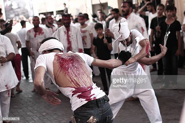 Bahrain Manama Bahraini Shia'a muslims taking a part during Tatbir procession in Manama the capital Tatbir is an act of mourning by Twelver Shi'i...