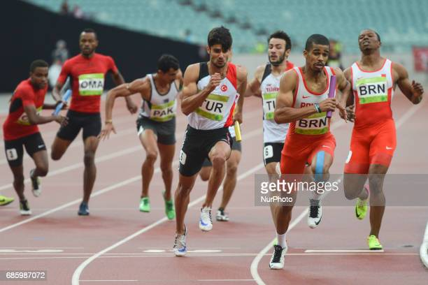 Bahrain Relay leads ahead of Turkish Relay during Men's 4 x 400 Relay final during day five of Athletics at Baku 2017 4th Islamic Solidarity Games at...