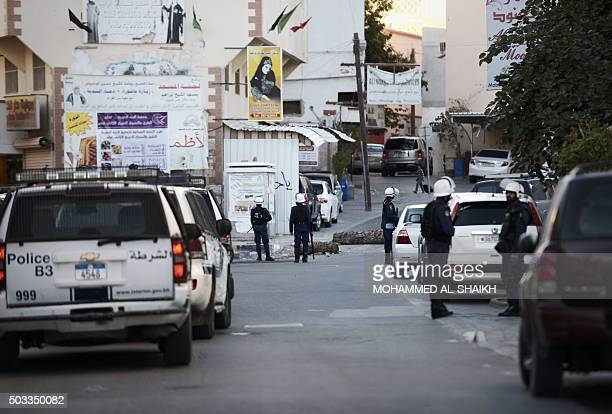 Bahrain riot police stand guard during clashes with protestors following a demonstration against the execution of prominent Shiite Muslim cleric Nimr...