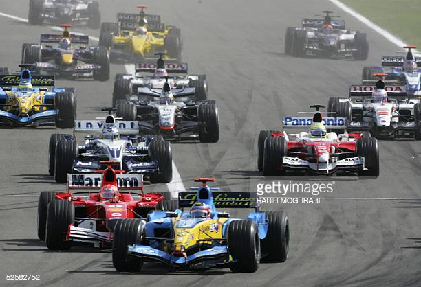 Spanish Renault driver Fernando Alonso leads the pack on the Sakhir racetrack after the start of the Bahrain Grand Prix, 03 April 2005 in Manama,...