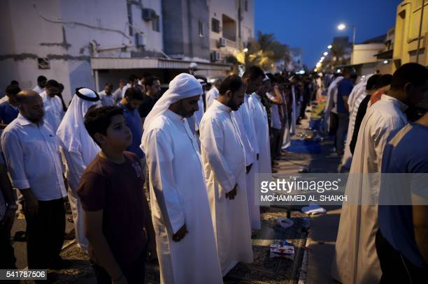 Bahraini demonstrators pray Maghrib prayer following a protest against the revocation of the citizenship of top Bahraini Shiite cleric Sheikh Isa...