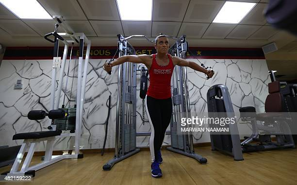 Bahraini female bodybuilder and personal trainer Haifa alMusawi trains at a gym in Dubai on June 26 2015 Proudly flexing her muscles in defiance of...