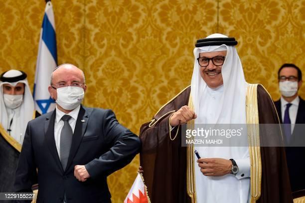 Bahraini Foreign Minister Abdullatif bin Rashid Al-Zayani and head of the Israeli delegation National Security Advisor Meir Ben Shabbat, bump elbows...