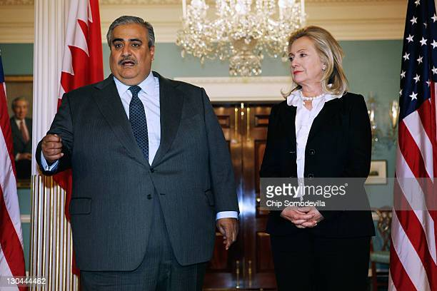 Bahraini Foreign Minister Shaikh Khalid bin Ahmed al-Khalifa and U.S. Secretary of State Hillary Clinton leave make brief remarks to the press in the...