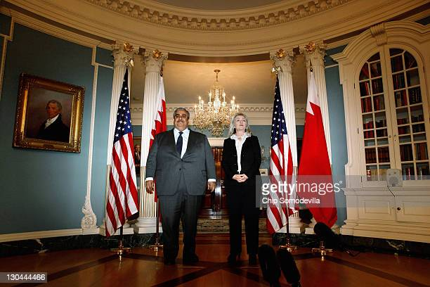 Bahraini Foreign Minister Shaikh Khalid bin Ahmed al-Khalifa and U.S. Secretary of State Hillary Clinton make brief remarks in the Treaty Room before...