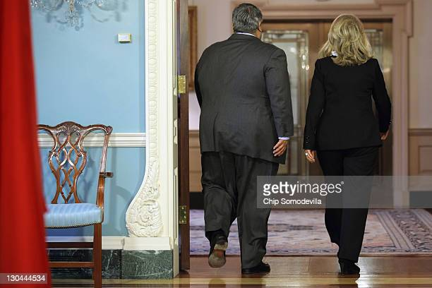 Bahraini Foreign Minister Shaikh Khalid bin Ahmed al-Khalifa and U.S. Secretary of State Hillary Clinton leave after a media availability in the...