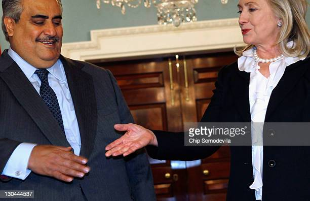 Bahraini Foreign Minister Shaikh Khalid bin Ahmed al-Khalifa reaches out to shake hands with U.S. Secretary of State Hillary Clinton in the Treaty...