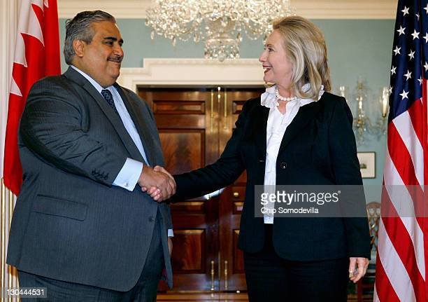 Bahraini Foreign Minister Shaikh Khalid bin Ahmed al-Khalifa shakes hands with U.S. Secretary of State Hillary Clinton in the Treaty Room before...
