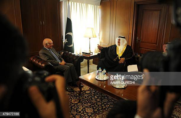 Bahraini Foreign Minister Sheikh Khaled bin Ahmed alKhalifa speaks with Pakistan's Adviser for National Security and Foreign Affairs Sartaj Aziz...