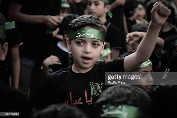 Bahraini girl in the village of Sanabis during the celebration of Ashura when Shiite Muslims who Igionh each year to commemorate the death of Imam...