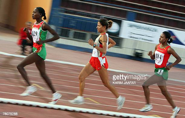 Bahraini gold medal winner Nadia alJafaini competes with Moroccan silver medalist Maria Laghrisi and Sudanese bronze winner Mashaar Ali during the...