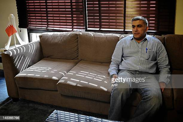 Bahraini human rights activist Nabeel Rajab sits at his home in the village of Bani Jamrah West of Manama on May 28 2012 upon his release on bail...