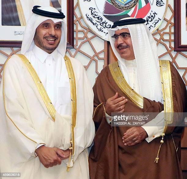 Bahraini Interior Minister Rashed bin Abdullah bin Ahmad Al Khalifa speaks with Qatari Minister of State for Internal Affairs Abdullah bin Nasser bin...