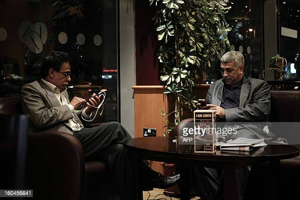 Bahraini men browse twitter on their smartphone in a coffee shop in the capital Manama on January 29, 2013. Twitter's unmatched platform for public...