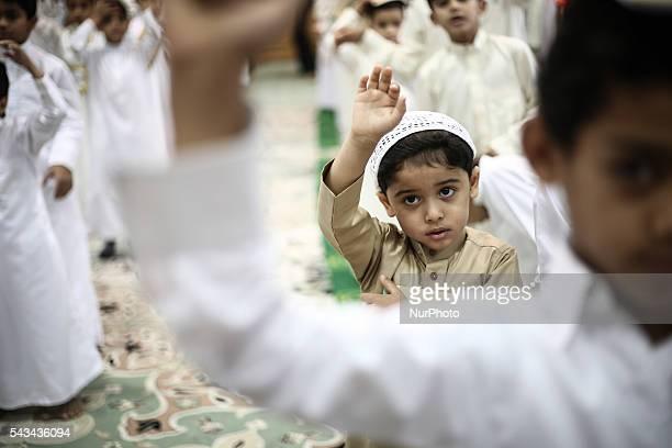 Bahraini Muslim children read the holy Quran while observing Qadr night in Ramadan in Manama Bahrain on June 28 2016