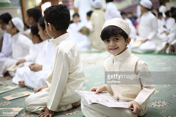 Bahraini Muslim children read the holy Quran while observing Qadr night in Ramadan in Manama Bahrain on June 28 2016