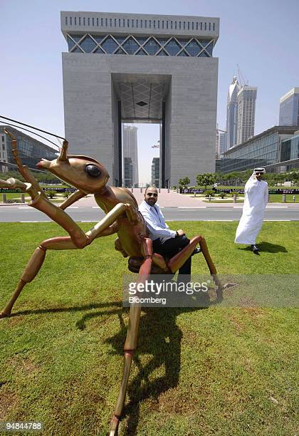 Bahraini national Bashar alShroogi owner of Cuadro Fine Art Gallery poses with a sculpture of an ant in front of the Dubai International Financial...
