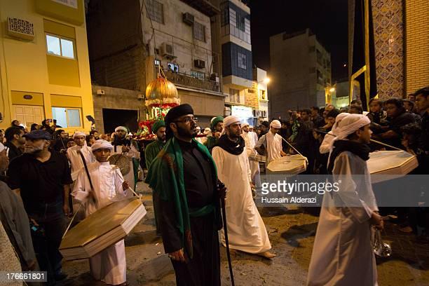 CONTENT] Bahraini people celebrate Asuraa in the capital city of Manama Nov 2012