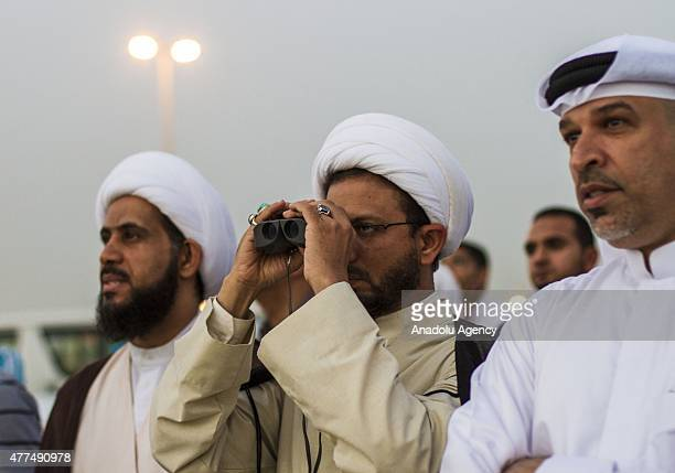 Bahraini people look for the location of the moon with binuculars to determine the beginning of holy Month of Ramadan in Sitra Bahrain on June 17 2015