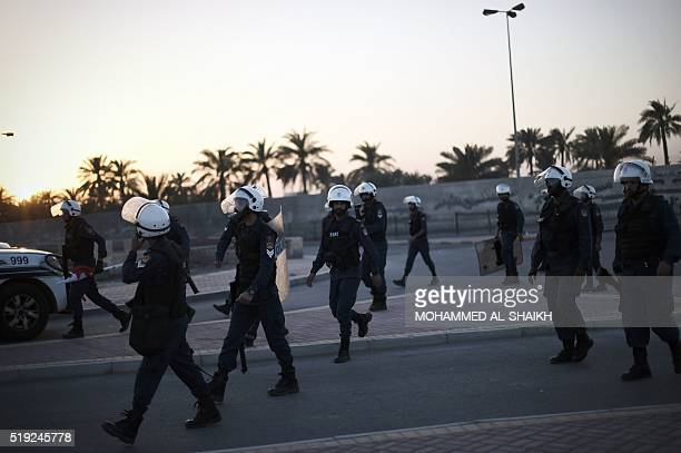 Bahraini police leave after dispersing protestors during clashes following the funeral of Ali Abdulghani whose family says died of injuries suffered...