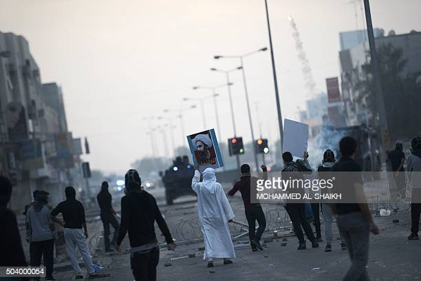 Bahraini protesters clash with riot police during clashes in the village of Sitra south of the capital Manama on January 8 following a protest...