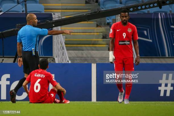 Bahraini referee Nawaf Shukralla points to the penalty spot during the AFC Champions League Round of 16 match between Saudi's AlAhli and UAE's Shabab...